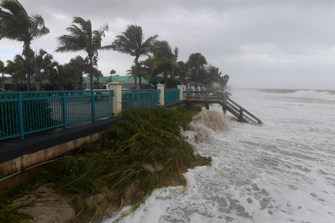 Community members come to take photos and see the waves on the beach at Sexton Plaza on Tuesday, Sept. 3, 2019 as the outer bands of Hurricane Dorian reach the Treasure Coast. Local beaches and dunes have seen major erosion over the past 48 hours due to the high winds and surf. Winds have already reached their peak along the Treasure Coast, according to the National Weather Service.