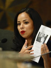 """Mayor pro tempore Claudia Ordaz Perez shows a photo of the Facebook post showing city Rep. Cassandra Hernandez posing with San Jacinto Plaza in the background. It said,  """"Cassandra Hernandez for Mayor of El Paso, Texas."""""""