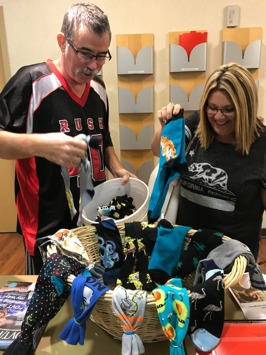 Eric and Wendy Anderson deliver crazy and colorful socks to inspire those caring for cancer patients in Visalia.