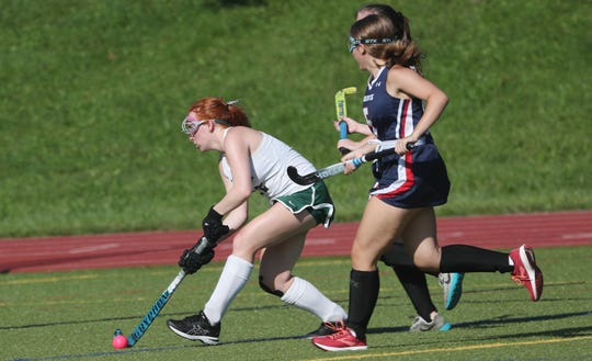 From left, Pleasantville's Ryan Sullivan fires off a shot against Byram Hills during field hockey action in Pleasantville's Autism Awareness Tournament at Pleasantville High School Sept. 3, 2019.  Pleasantville won the game 4-0.