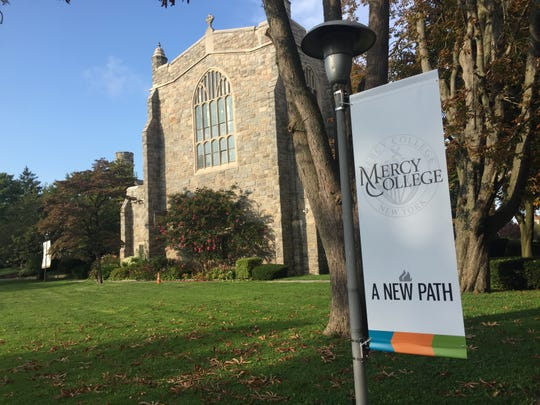 """Mercy College flags heralding """"A New Path"""" have replaced College of New Rochelle flags on CNR's former campus in New Rochelle, Sept. 2, 2019."""
