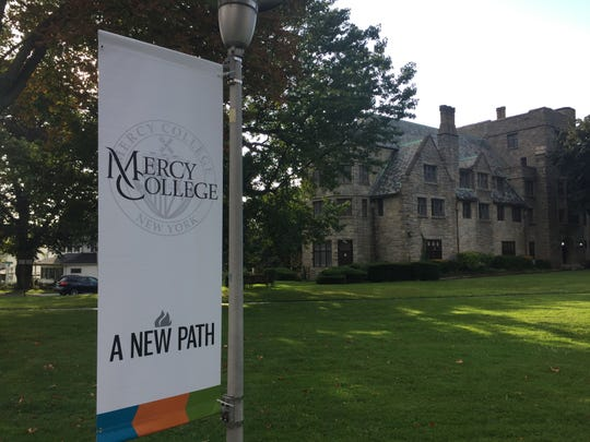 "Mercy College flags heralding ""A New Path"" have replaced College of New Rochelle flags on CNR's former campus in New Rochelle, Sept. 2, 2019."