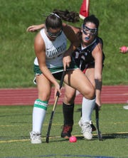 From left, Pleasantville's Sophie Ruhl (16) and Byram Hills' Victoria Vettoretti (14) battle for ball control during field hockey action in Pleasantville's Autism Awareness Tournament at Pleasantville High School Sept. 3, 2019.  Pleasantville won the game 4-0.