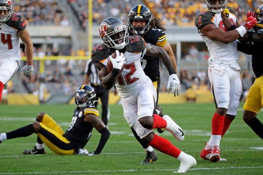 Tampa Bay Buccaneers wide receiver Chris Godwin (12) gets past Pittsburgh Steelers linebacker Anthony Chickillo (56) for a touchdown during the first half of an NFL preseason football game in Pittsburgh, Friday, Aug. 9.