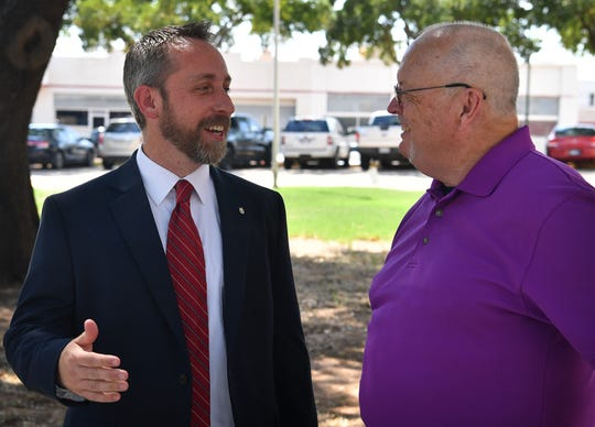James Hughes, left, talks with former Justice of the Peace Mike Little after Hughes announced his candidacy for Wichita County Justice of the Peace Precinct 1, Place 1, Tuesday afternoon.