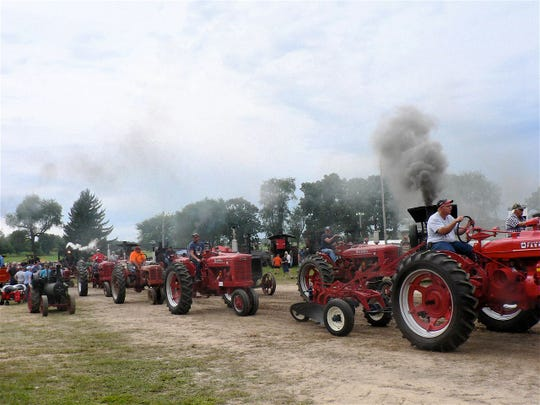 "More ""red"" in line for the parade. The smoke is from the ""firing up"" steam engines getting ready to go."