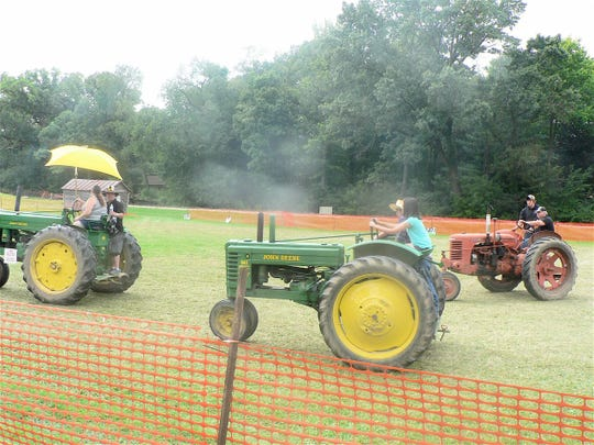Free learning rides for kids or those who never before drove a tractor is a popular feature at the Thresheree.