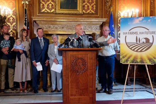 Democratic state Rep. David Considine gathers with supporters of three measures designed to help struggling Wisconsin farmers, Tuesday, Sept. 3, 2019, in Madison, Wis. Lawmakers, farmers and other supporters spoke in favor of the bill at a Capitol news conference Tuesday.