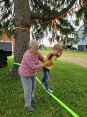 Susan balancing Harrison.