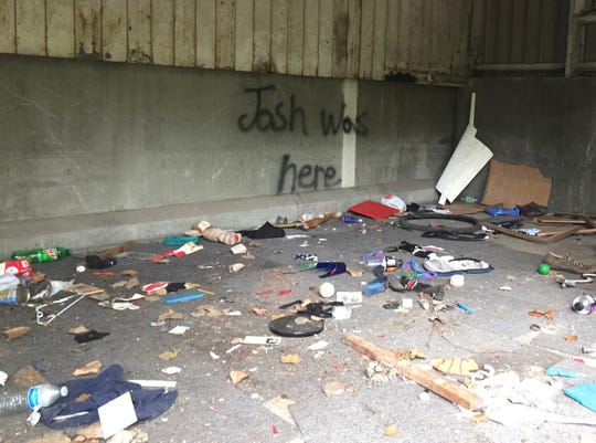 A locked room attached to an abandoned trucking facility was occupied by a homeless man who collected rent from other homeless individuals. Evidence of criminal activity, including drug use and prostitution, was left behind when the individuals were removed from the property.