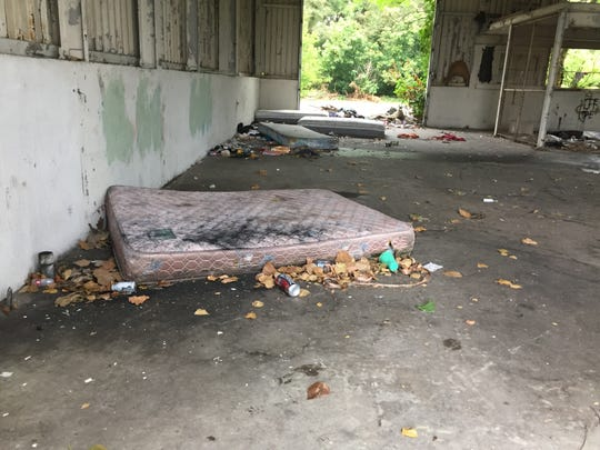 An abandoned trucking company provided shelter to at least eight homeless individuals who city officials removed earlier this year.