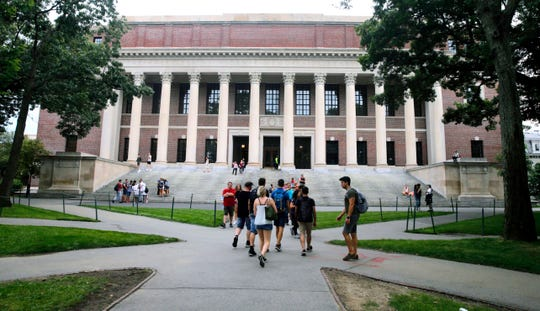 In this Aug. 13, 2019 file photo, students walk near the Widener Library in Harvard Yard at Harvard University in Cambridge, Mass. University and federal officials confirmed that incoming Harvard University student Ismail Ajjawi, 17, of Lebanon, was refused entry into the U.S. after landing at Logan International Airport in Boston on Friday, Aug. 23.