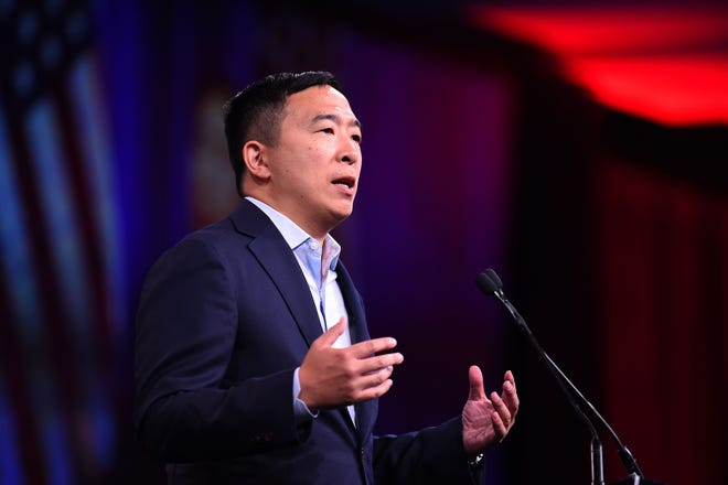 In this file photo taken on August 23, 2019 2020 US Democratic Presidential hopeful Andrew US entrepreneur Andrew Yang speaks on-stage during the Democratic National Committee's summer meeting in San Francisco, California.