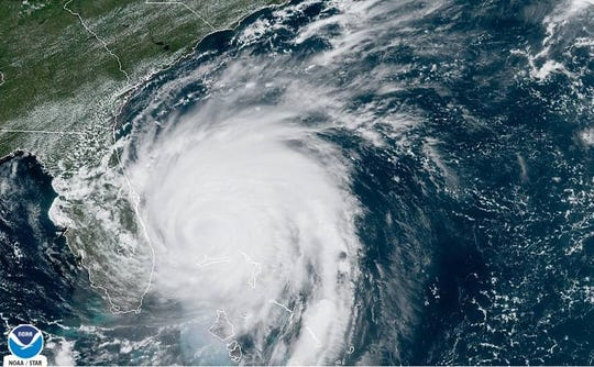 A satellite image taken Monday morning, Sept. 3, 2019, shows Hurricane Dorian spinning just east of Florida.