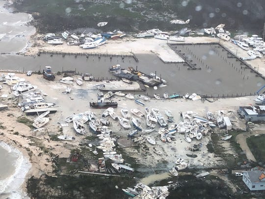 An aerial view shows destruction at a leisure boat harbor at the Bahamas after hurricane Dorian hit the islands on September 2, 2019.