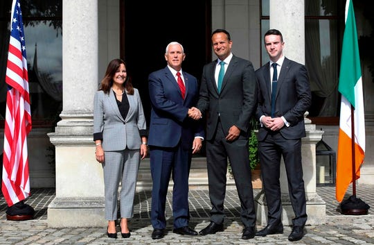 Irish Prime Minister Leo Varadkar (2R) and his partner Matthew Barrett (R) welcome US Vice President Mike Pence (L) and Second Lady Karen Pence (L) to Famleigh House in Phoenix Park, Dublin, on September 3, 2019, on day two of his visit to Ireland. (Photo by PAUL FAITH / AFP)