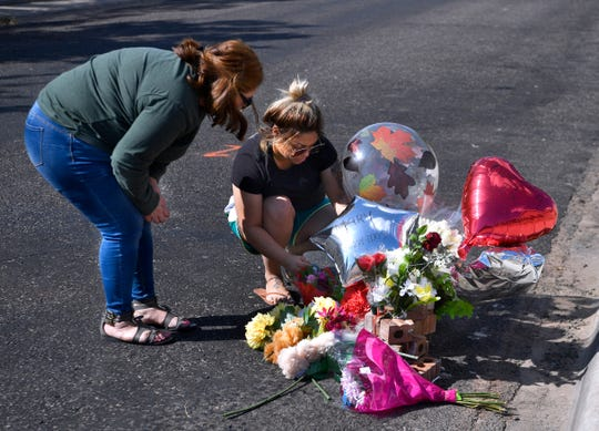Friends Evette (left) and Christine Garcia attach another balloon to a memorial on Adams Street to Odessa postal worker Mary Granados Monday Sept. 2, 2019. Granados was one of seven killed by Seth Ator, 36, who went on a shooting spree Saturday and struck nearly two dozen people with gunfire. (Via OlyDrop)