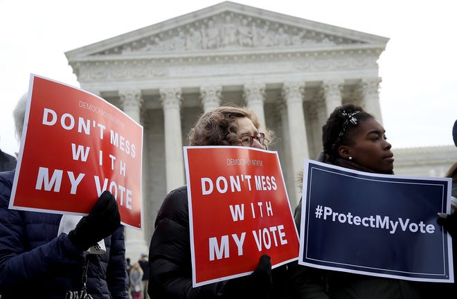 Activists rallied to oppose voter roll purges, one of the many election laws passed or contemplated by state legislatures across the country.