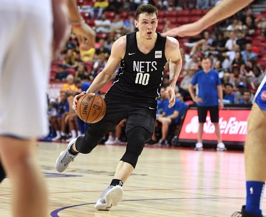 Nets forward Rodions Kurucs dribbles during the second half of a July 13 Summer League game against the Detroit Pistons in Las Vegas.