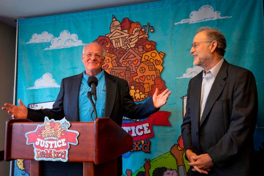"""Ben and Jerry's cofounders Ben Cohen (L), and Jerry Greenfield speak as they unveil the new Ben & Jerry's flavour """"Justice ReMix'd"""" about criminal justice reform during a press conference in Washington, DC, on September 3, 2019."""
