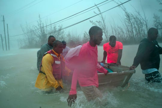 Volunteers rescue several families from the rising waters from Hurricane Dorian, near the Causarina Bridge in Freeport, Grand Bahama, Bahamas on Sept. 3, 2019.