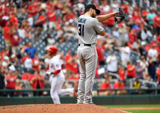 Marlins pitcher Caleb Smith reacts after giving up a home run to Nationals catcher Yan Gomes.