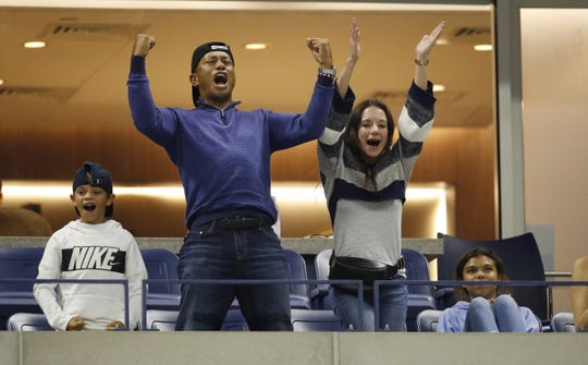 Golfer Tiger Woods cheers for Rafael Nadal against Marin Cilic.