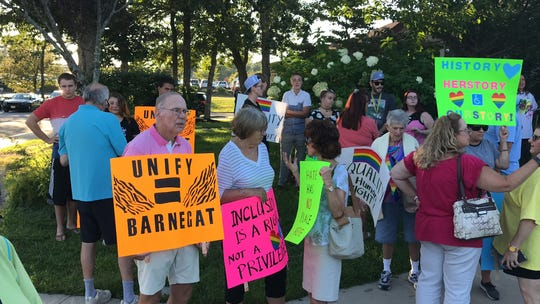 Residents who support teaching LGBT history in schools gather outside the Barnegat municipal building on Tuesday to oppose statements by Mayor Alfonso Cirulli.