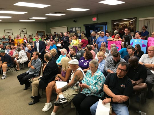 Barnegat residents, some in support and some opposed to comments made by Mayor Alfonso Cirulli about LGBT issues, fill Town Hall on Tuesday.