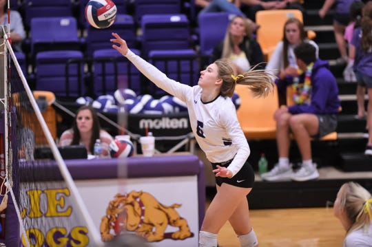 Wylie's Jaron McAden (6) pushes the ball over the net against San Angelo Central. McAden had two kills and two blocks in the third set as the Lady Bulldogs won 3-0.