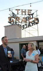 Mark Rogers, armed with coffee to start his day, talks with Cathy Ashby, president and CEO of United Way of Abilene, before the 2019 kickoff Wednesday morning atop The Grace Museum. Rogers is president of the Abilene branch of Big Brothers Big Sisters, which received a sizable check from United Way at the event.