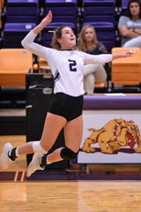 Wylie's Avery Wimberly (2) goes up for a kill against San Angelo Central at Bulldog Gym on Tuesday.