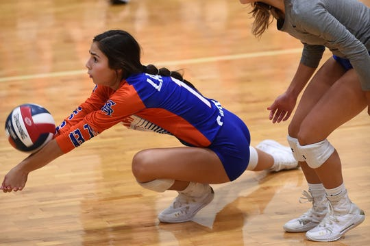 San Angelo Central's Hannah Gomez (1) dives for the ball against Abilene Wylie at Bulldog Gym on Tuesday, Sept. 3, 2019. The Lady Bulldogs won in three sets.