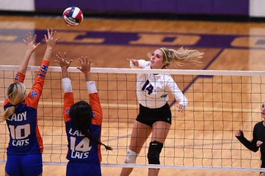 Wylie's Maggie Allen (14) follows through on a kill attempt against San Angelo Central earlier this month. Allen returned this season after missing last year with an injury and has been a boost in the middle at the net.