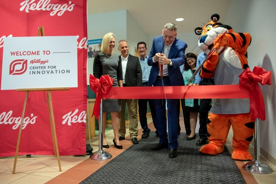 Nigel Hughes, head of research and development at Kellogg Co., unveils the new Center for Innovation with help from Tony the Tiger on Wednesday, Sept. 4, 2019 at W.K. Kellogg Institute for Food and Nutrition Research in Battle Creek, Mich.