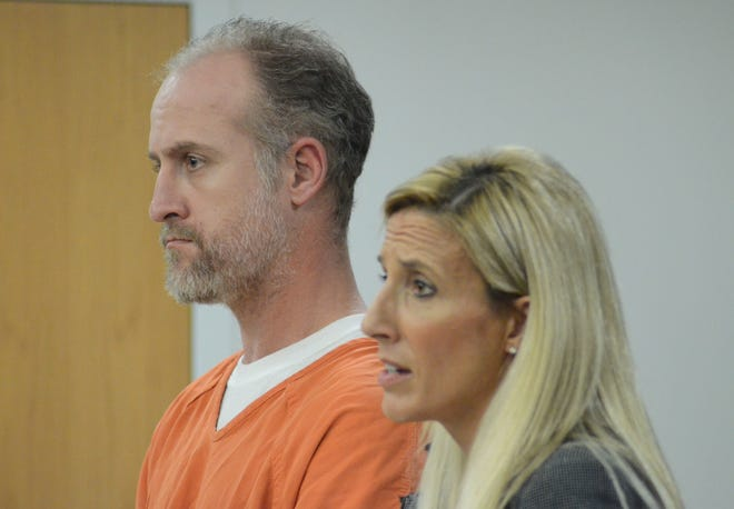 Kyland Hudson stands beside his attorney, Jennifer Kuiper-Weise in December 2017 when he was to 30 to 60 years in prison.