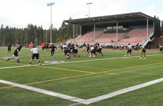 CK Cougar football runs through plays during practice at Central Kitsap High School's Kitsap Credit Union Athletic Complex in Silverdale on Tuesday, September 3, 2019.