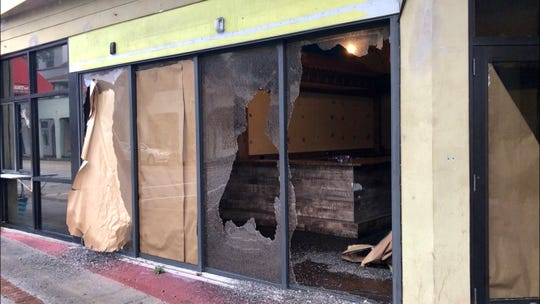Someone shattered the front windows of the former Ole Fire Grill during Hurricane Dorian in downtown Melbourne.