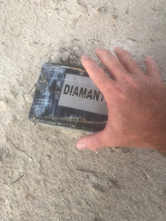 Melbourne police said a brick of sealed cocaine washed up in the rough surf stirred by Hurricane Dorian