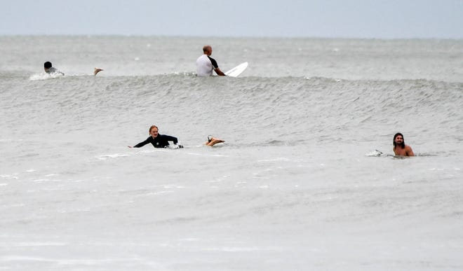 Surfers ride the waves generated by Hurricane Dorian near Fifth Ave in Indialantic, FL Mandatory Credit: Craig Bailey/FLORIDA TODAY via USA TODAY NETWORK
