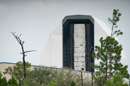 SpaceX's Starship prototype is seen in its Cocoa hangar on Wednesday, Sept. 4, 2019 after Hurricane Dorian swept by the Space Coast.