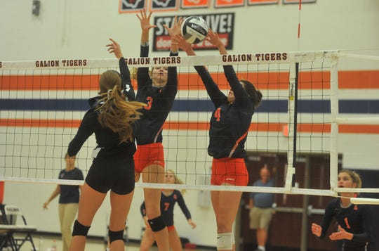 Galion's Taylor Keeran and Jaden Ivy block a tip from Clear Fork's Aubrey Bailey at the net.