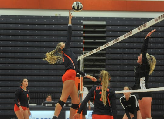 Galion's Taylor Keeran reaches up to push a ball over the net above Clear Fork's Kali Weikle.