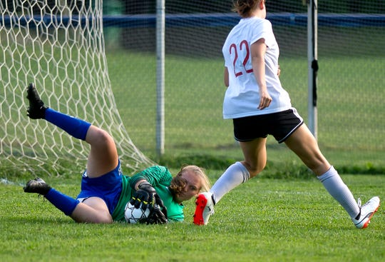 Colchester's Olivia Moore, left, gobbles up a loose ball ahead of Champlain Valley's Josie Pecor during a high school girls soccer game in Colchester on Tuesday, Sept. 3, 2019.