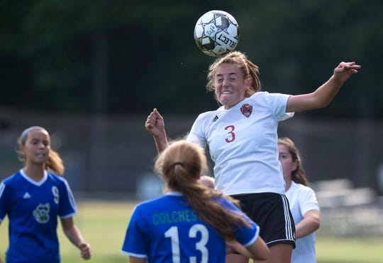 Champlain Valley's Olivia Zubarik wins a header against Colchester during a high school girls soccer game in Colchester on Tuesday, Sept. 3, 2019.