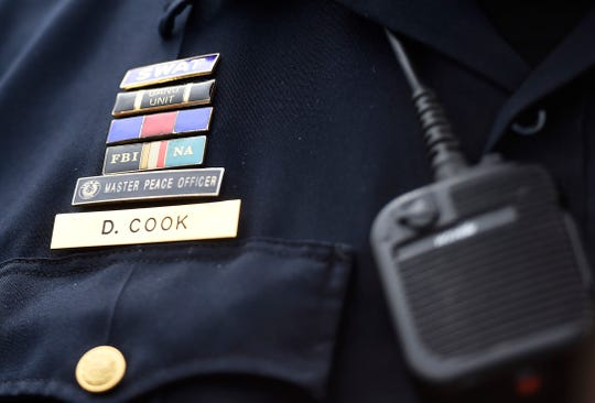 Corpus Christi Police Capt. Dave Cook wears various pins at a press conference regarding a shooting, Wednesday, Sept. 4, 2019. Officers received a call to an apartment complex, then later another call for a shooting victim at an urgent care facility on South Staples street, according to Cook.