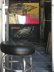 A stool sits near an entrance to the former Pennant East, a long-vacant club that faces possible demolition in Bellmawr.