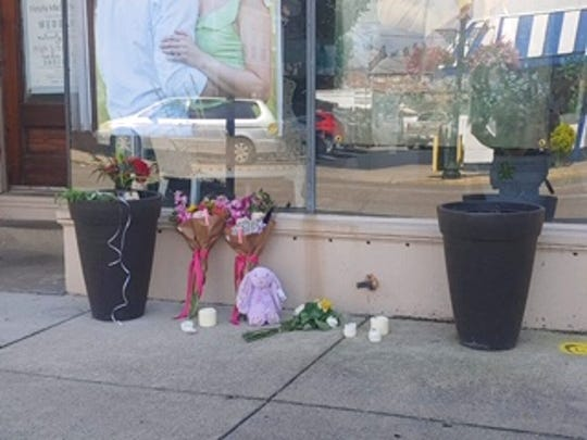 An impromptu shrine to commemorate Victoria Schafer is set outside Schafer's photography business on Sept. 4, 2019.