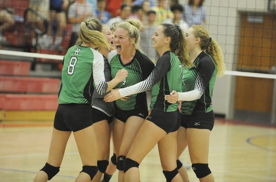 Huntington's Allison Basye and Alyssa Steele celebrate with teammates during a 3-1 win over Zane Trace at Zane Trace High School in Chillicothe, Ohio on Tuesday Sept. 3, 2019.