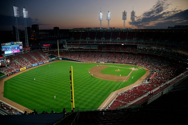 The sunsets during the fifth inning of the MLB National League game between the Cincinnati Reds and the Philadelphia Phillies at Great American Ball Park in downtown Cincinnati on Tuesday, Sept. 3, 2019. The game was tied 1-1 after three innings.